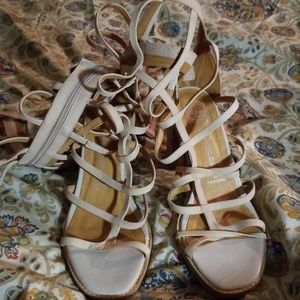A pair of Jeffery Campbell gladiators sandals